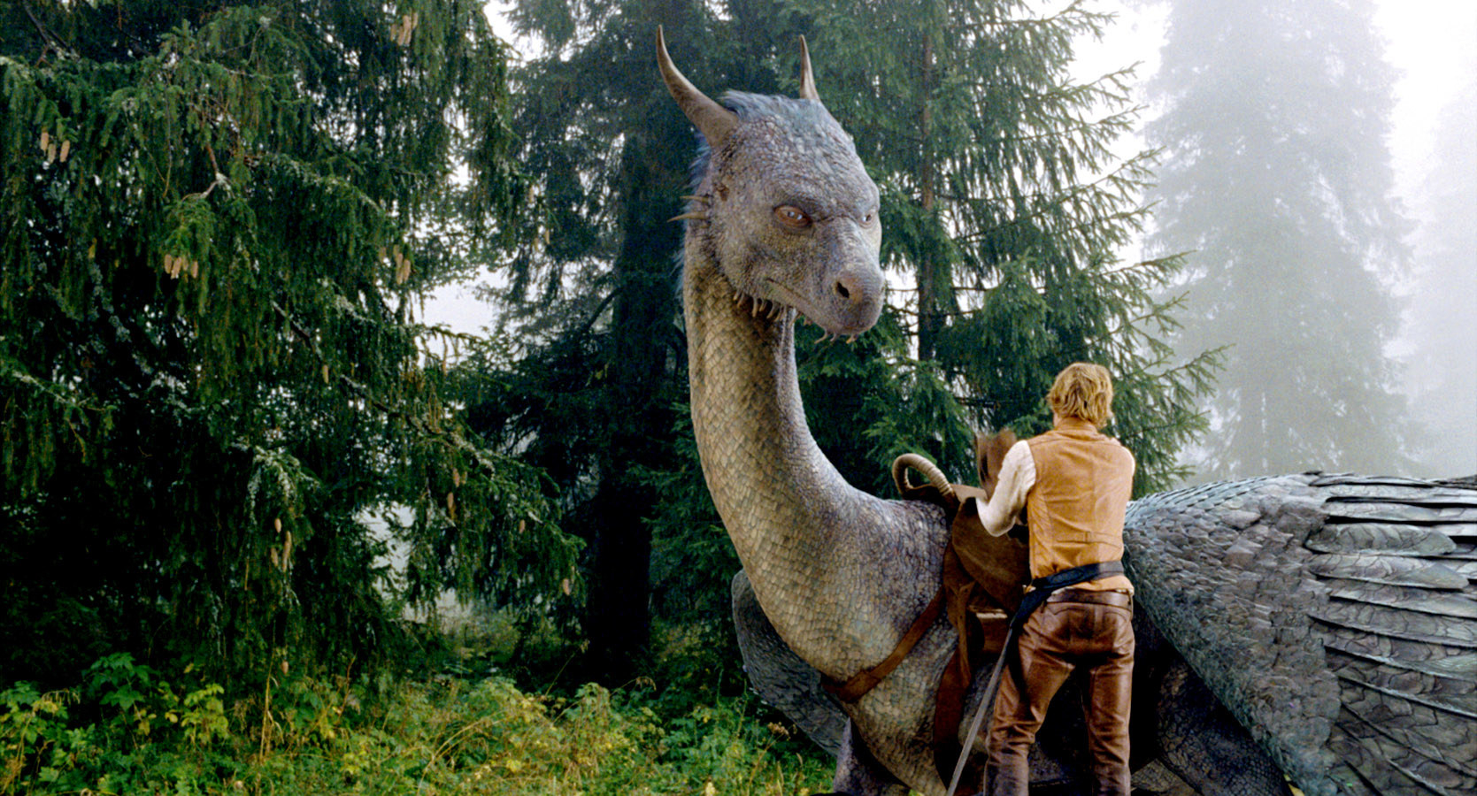 "Edward Speleers with a dragon in the movie ""Eragon"""