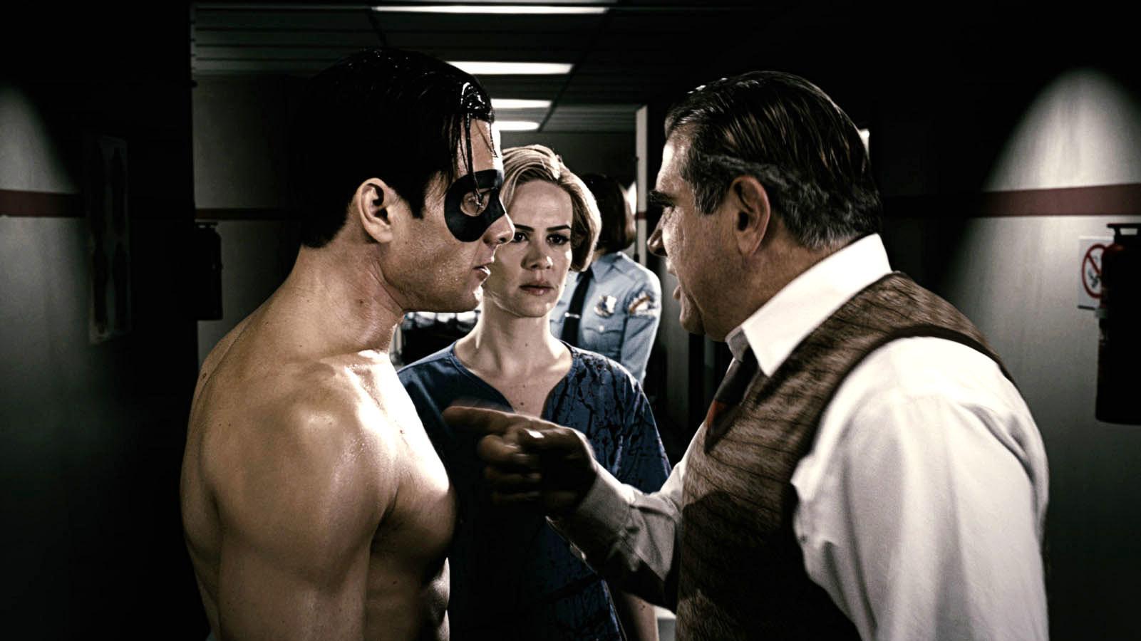 "Gabriel Macht, Sarah Paulson, and Dan Lauria have a tense conversation in ""The Spirit"""