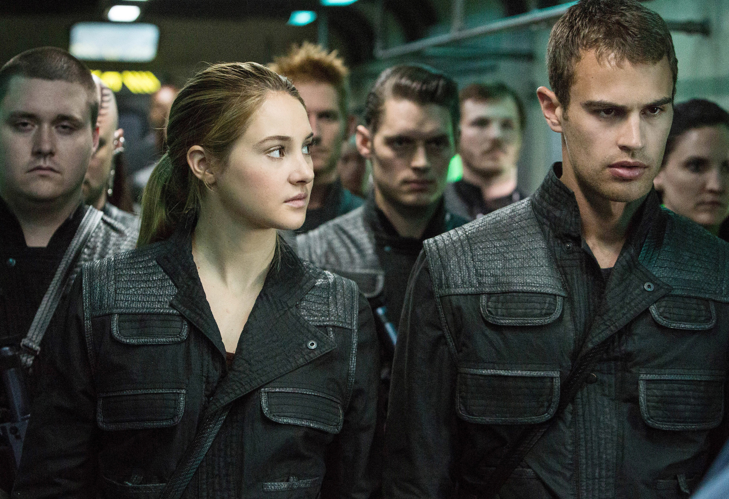 "Shailene Woodley and Theo James waiting in a room with other people in ""Divergent"""
