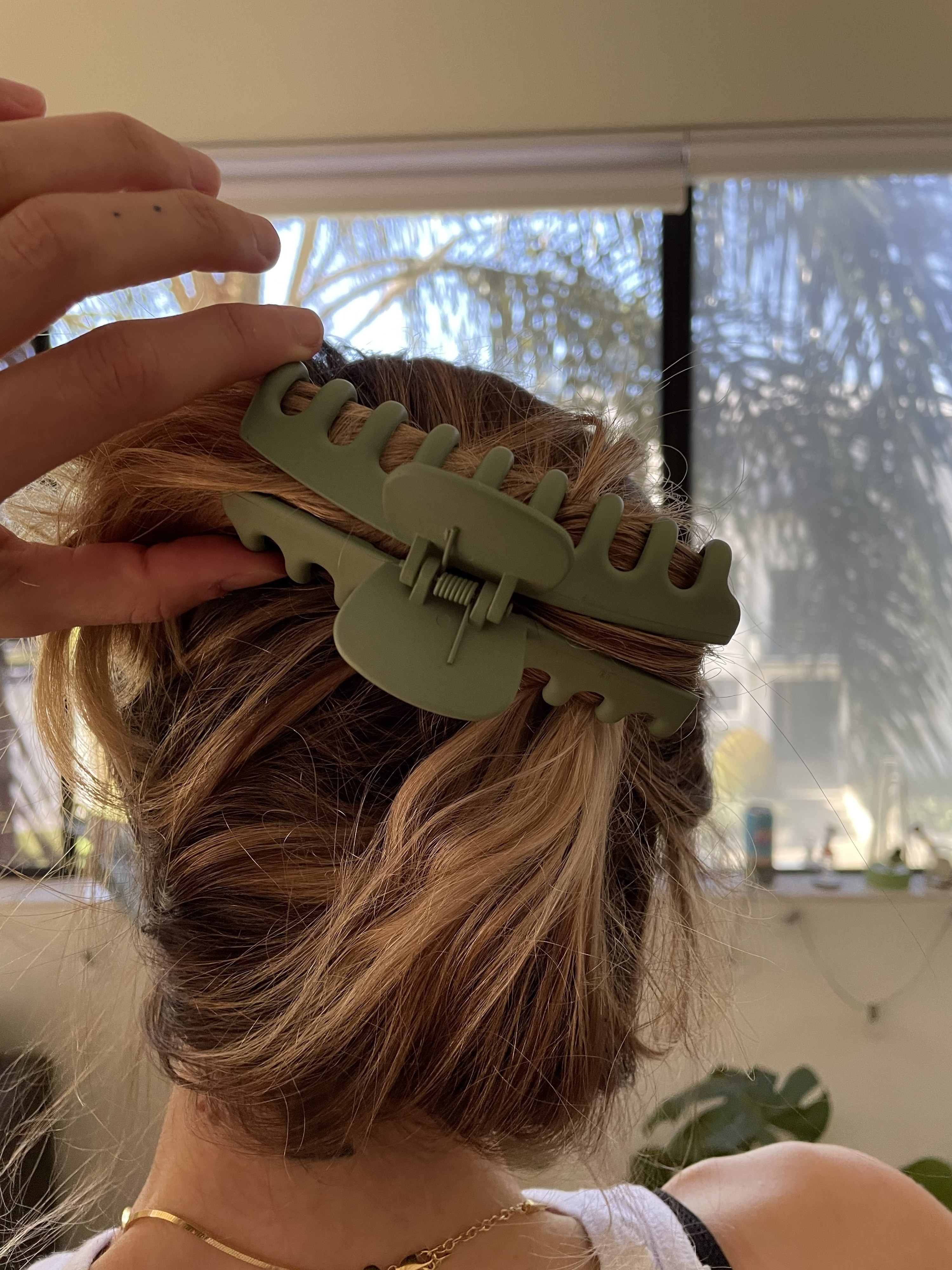 An image of the back of the author's head with her hair clipped with one of the big hair clips