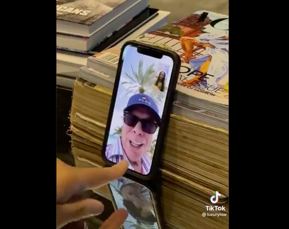 Tommy Hilfiger on Law's phone screen