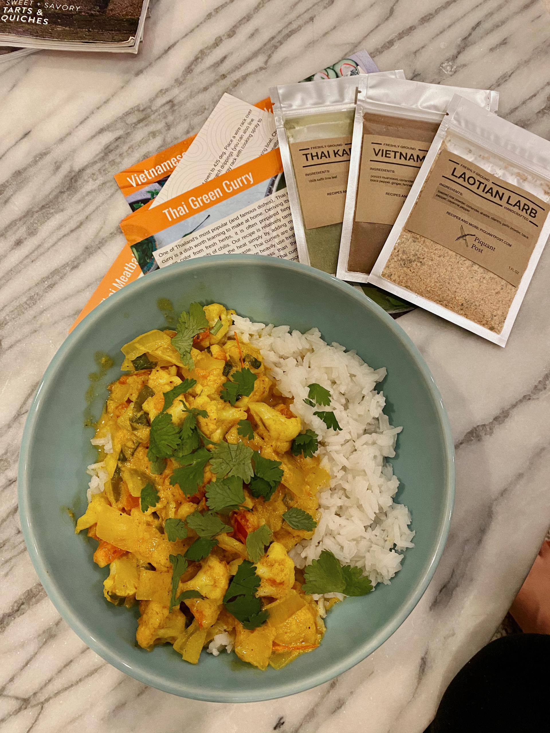 kayla's plate of curry and rice next to several spice packets