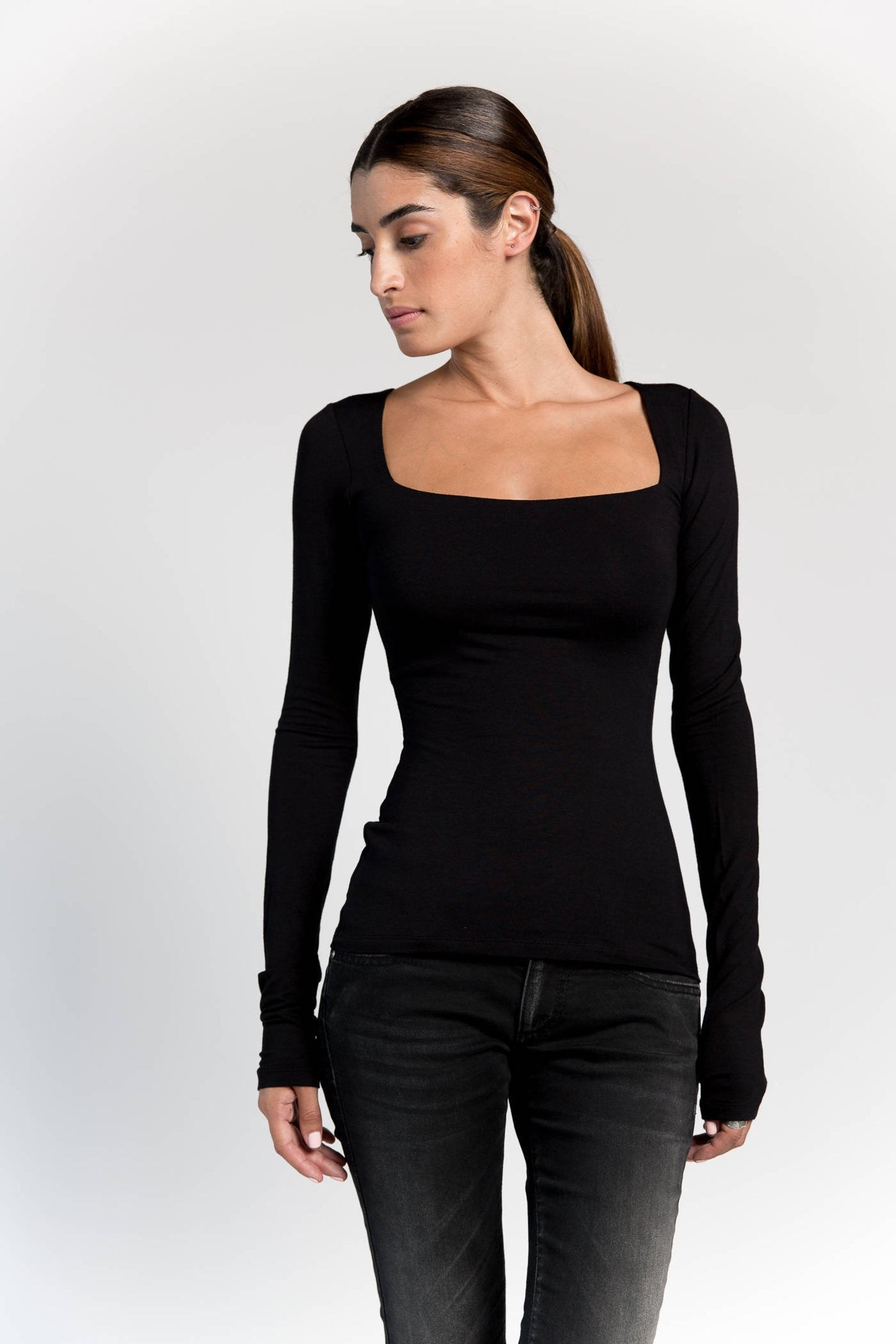 front view of a model wearing the top in black