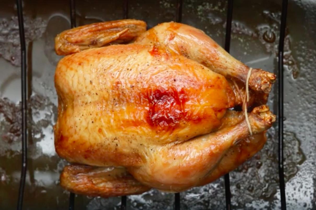 A roast chicken on a rack.