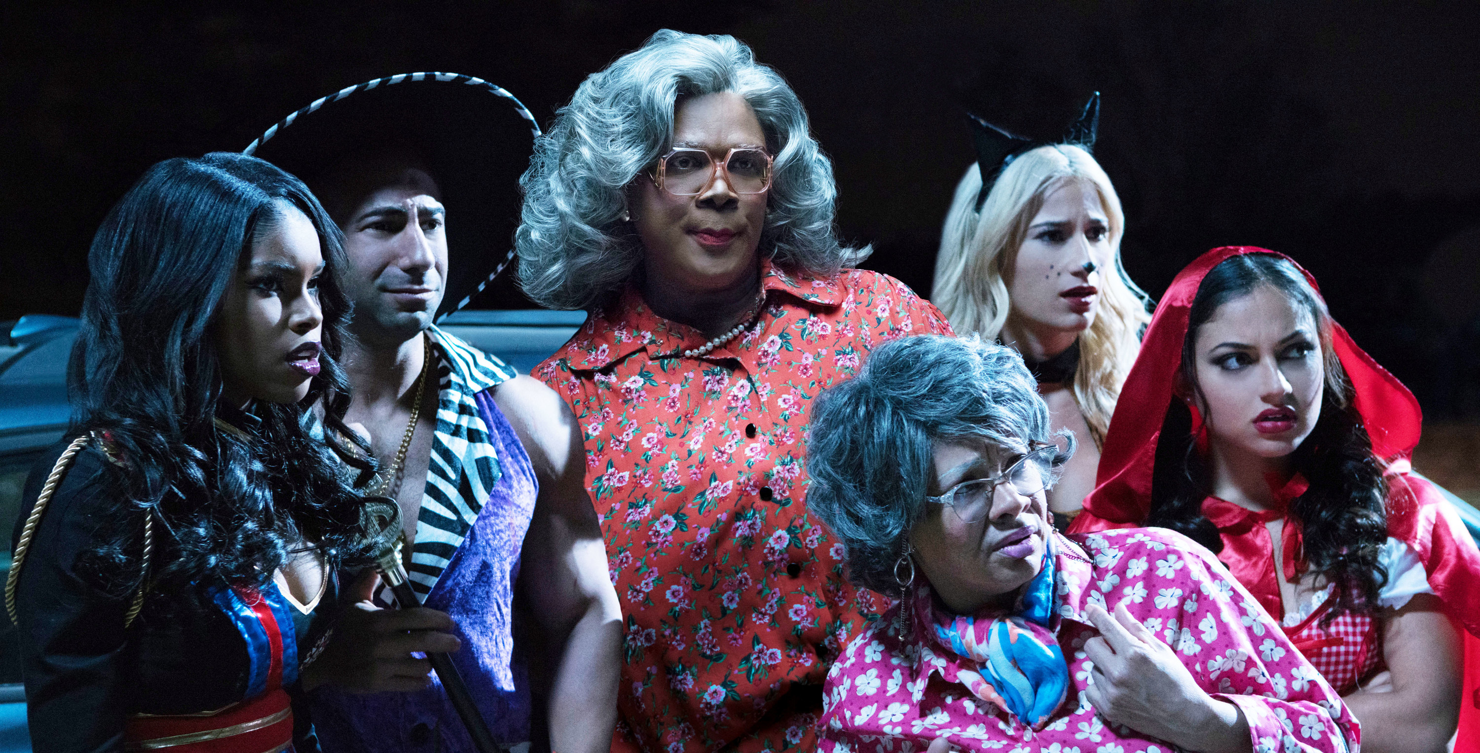 "Diamond White, Yousef Erakat, Tyler Perry, Patrice Lovely, Lexy Panterra, Inanna Sarkis dressed in Halloween costumes during a scene in ""Boo 2! A Madea Halloween"""
