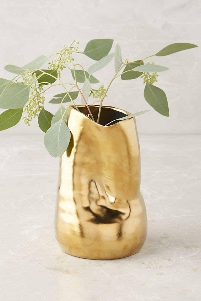the gold ceramic vase