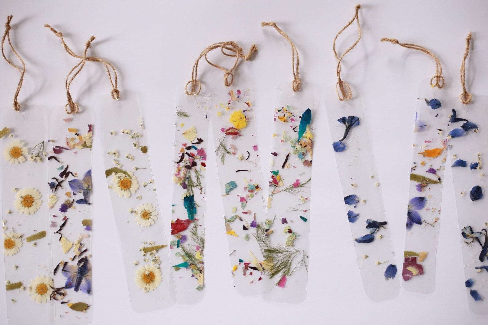 Transparent bookmarks with dried pressed flowers in them