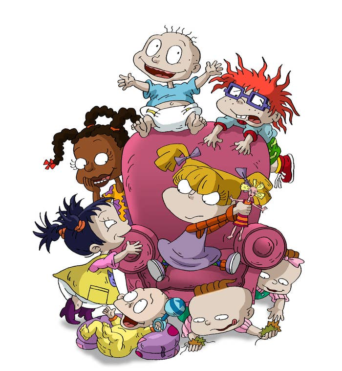 The Rugrats playing on a couch as Angelica  tries to keep her doll safe