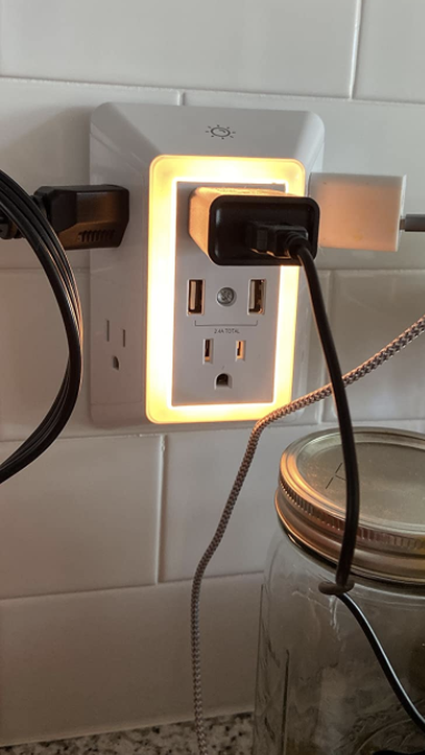 wall outlet adapter that lights up and can fit multiple plugs