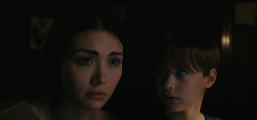 Child looking at a concerned woman