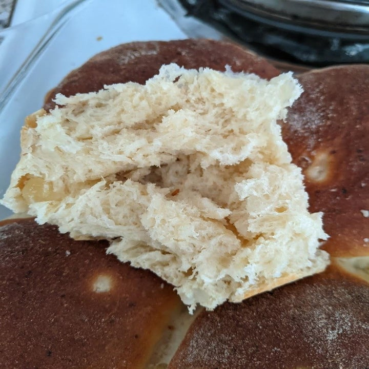 The doughy, fluffy interior of a dinner roll.