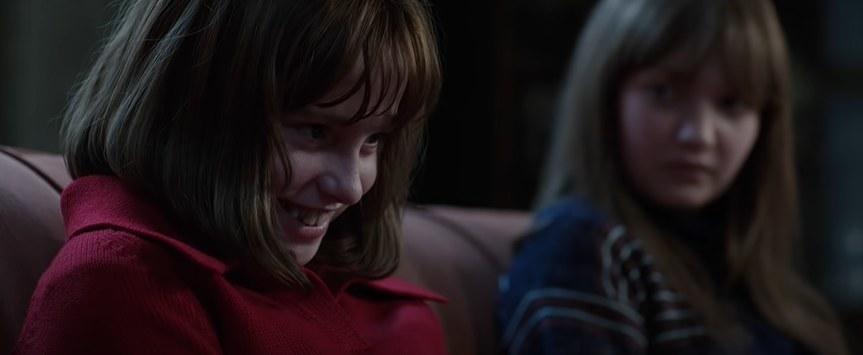 Girl smiling sinisterly