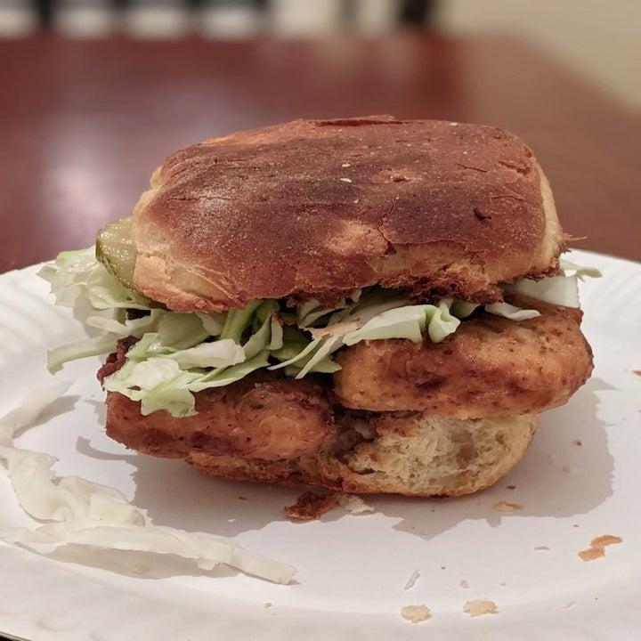 A chicken sandwich on a dinner roll.