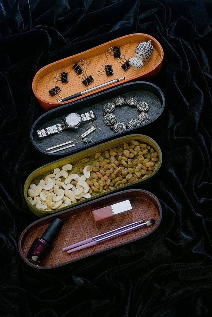 Four different designs of the tray with various items kept inside.