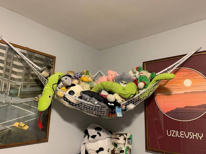 The hammock hung in a corner and filled with toys