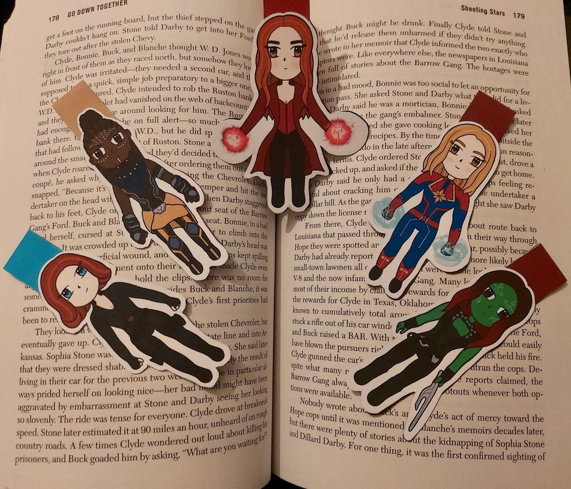 Five bookmarks on an open book