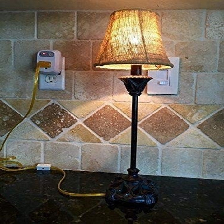 a lamp plugged into the outlet