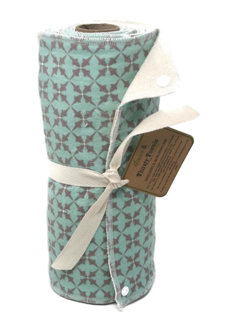 roll of mint and gray patterned fabric towels