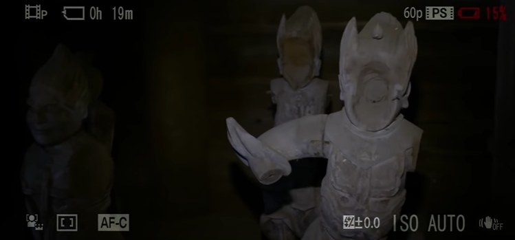 Faceless statues inside a temple