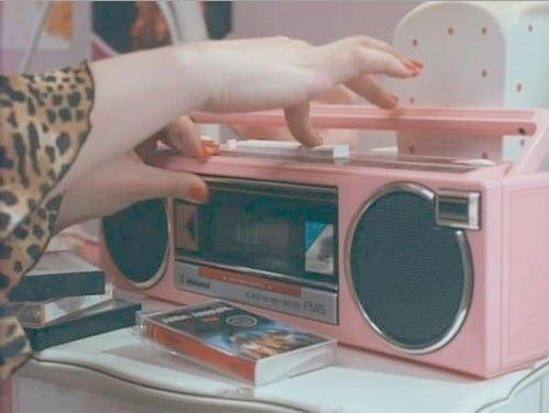Someone recording over a cassette tape on an old radio