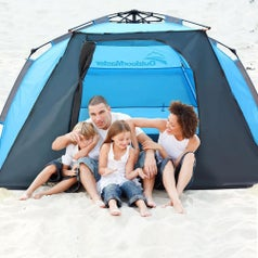 A family of four hanging out in the tent