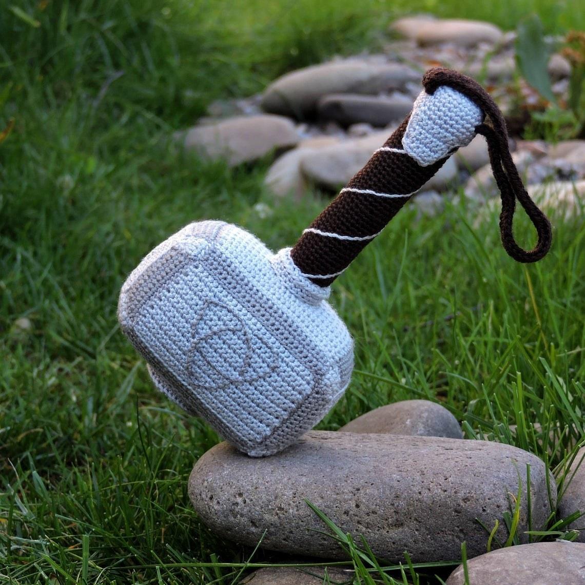 The stuffed hammer on a rock