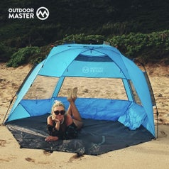 A model sits in the tent on the beach
