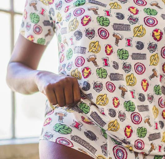 Person wearing undies with Marvel superhero logos and masks with a matching shirt