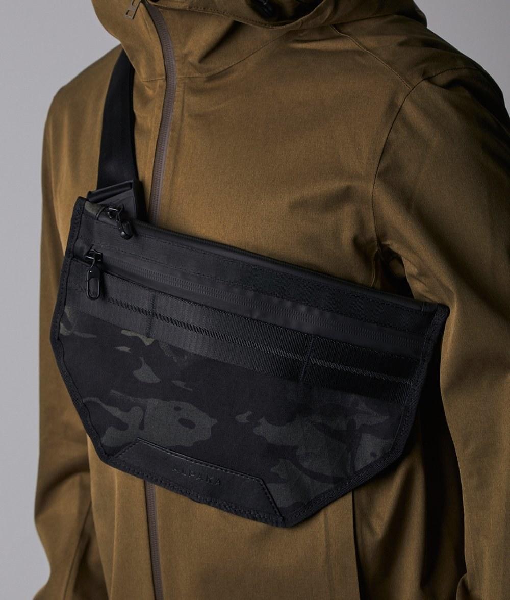 Model wearing the black camo printed bag