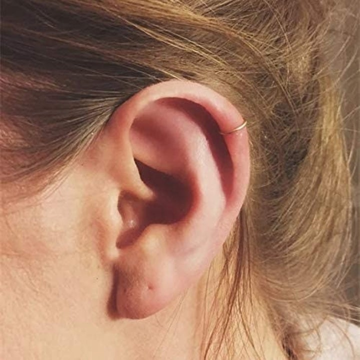 Model with the gold earrings on their upper ear