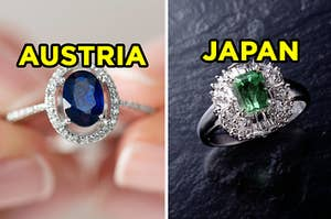 "On the left, an oval sapphire ring labeled ""Austria,"" and on the right, an emerald ring surrounded by diamonds labeled ""Japan"""