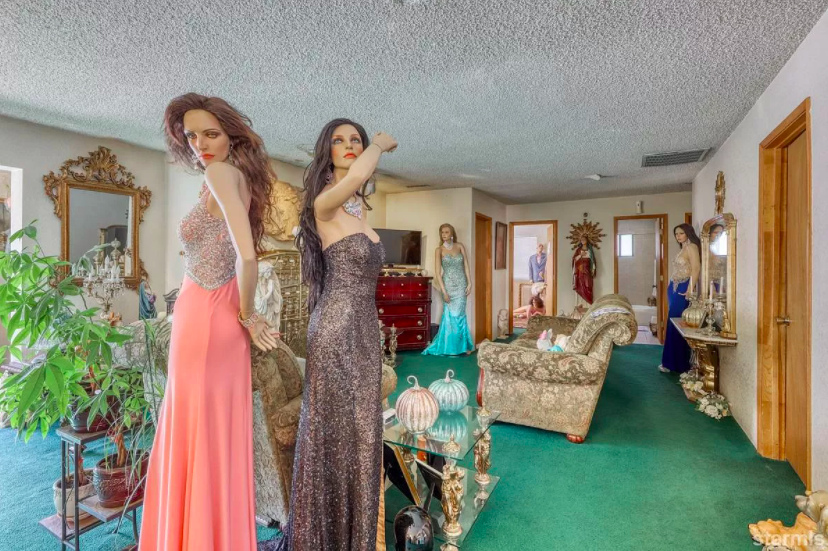 Several more female mannequins dressed in a long wigs and sequined evening gowns of various colors and styles
