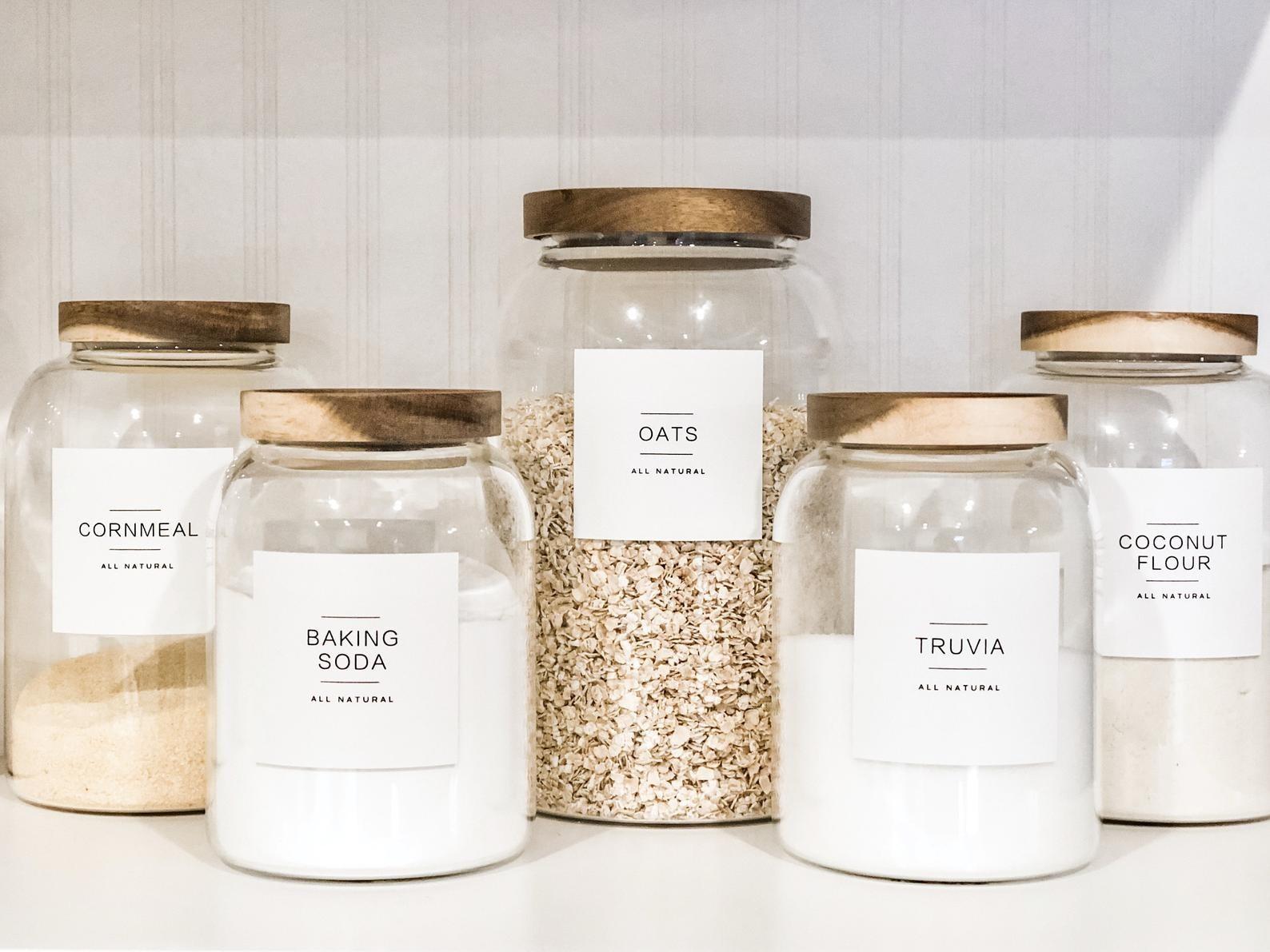 Cornmeal, baking soda, oats, truvia, and coconut flour labels on glass jars