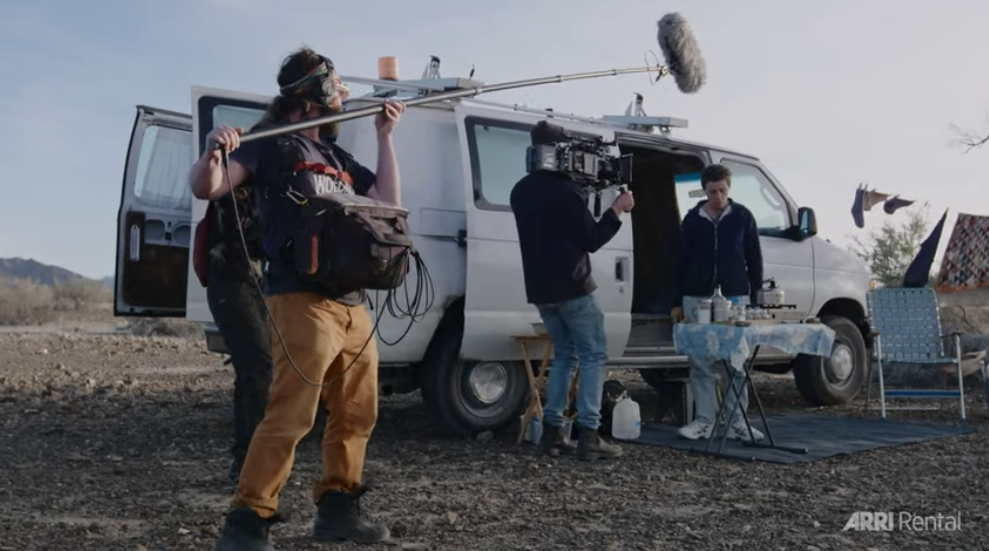 A boom operator, camera man, and assistant film Frances outside her van