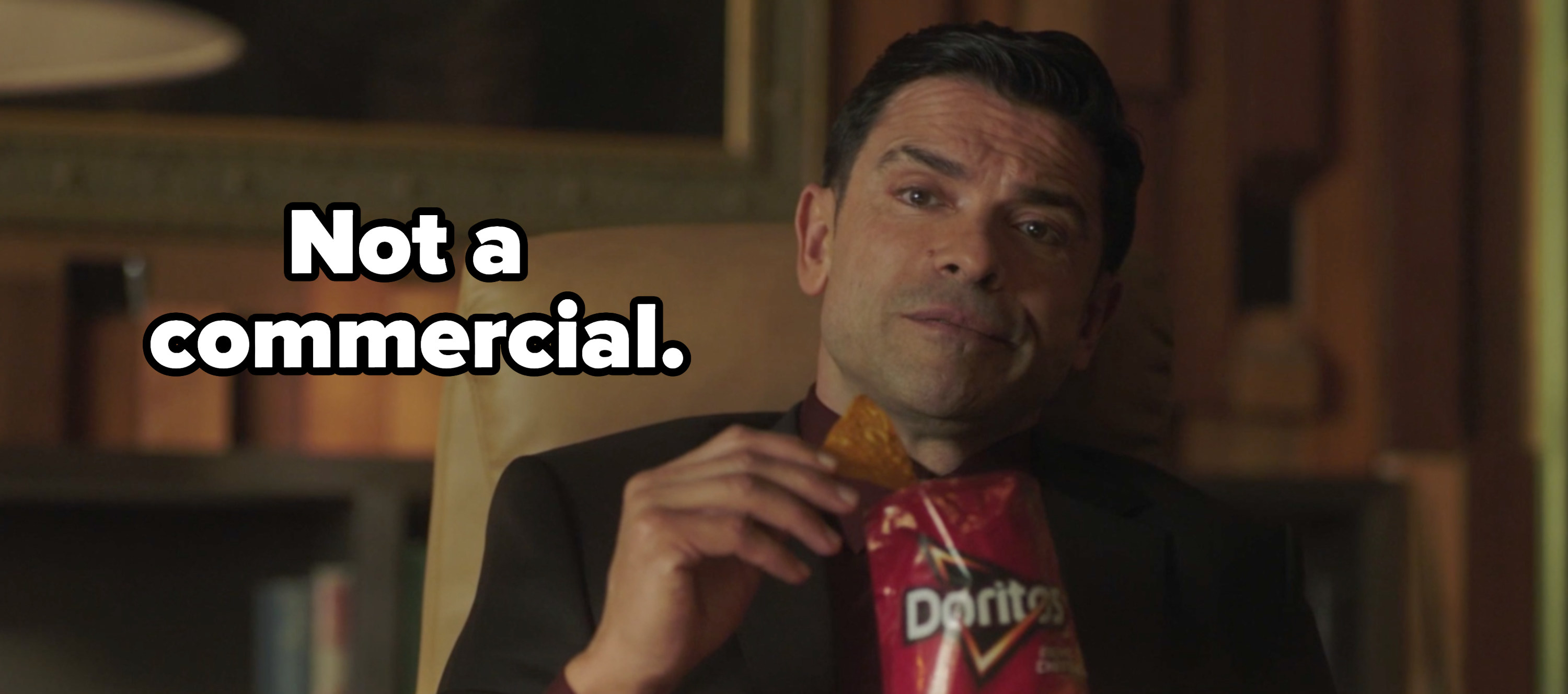 """Hiram eating doritos with the caption """"not a commercial"""""""