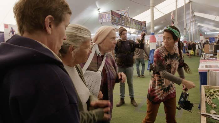 Chloé Zhao directs members of the cast at an RV show