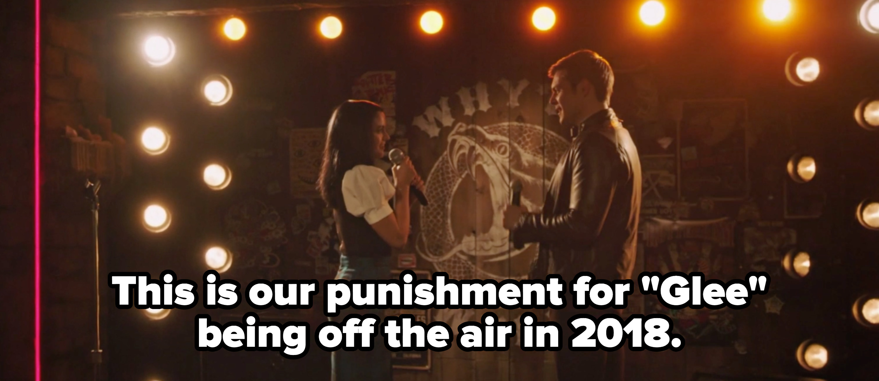 """Veronica and Chad singing with the caption """"this is our punishment for """"glee"""" being off the air in 2018"""""""