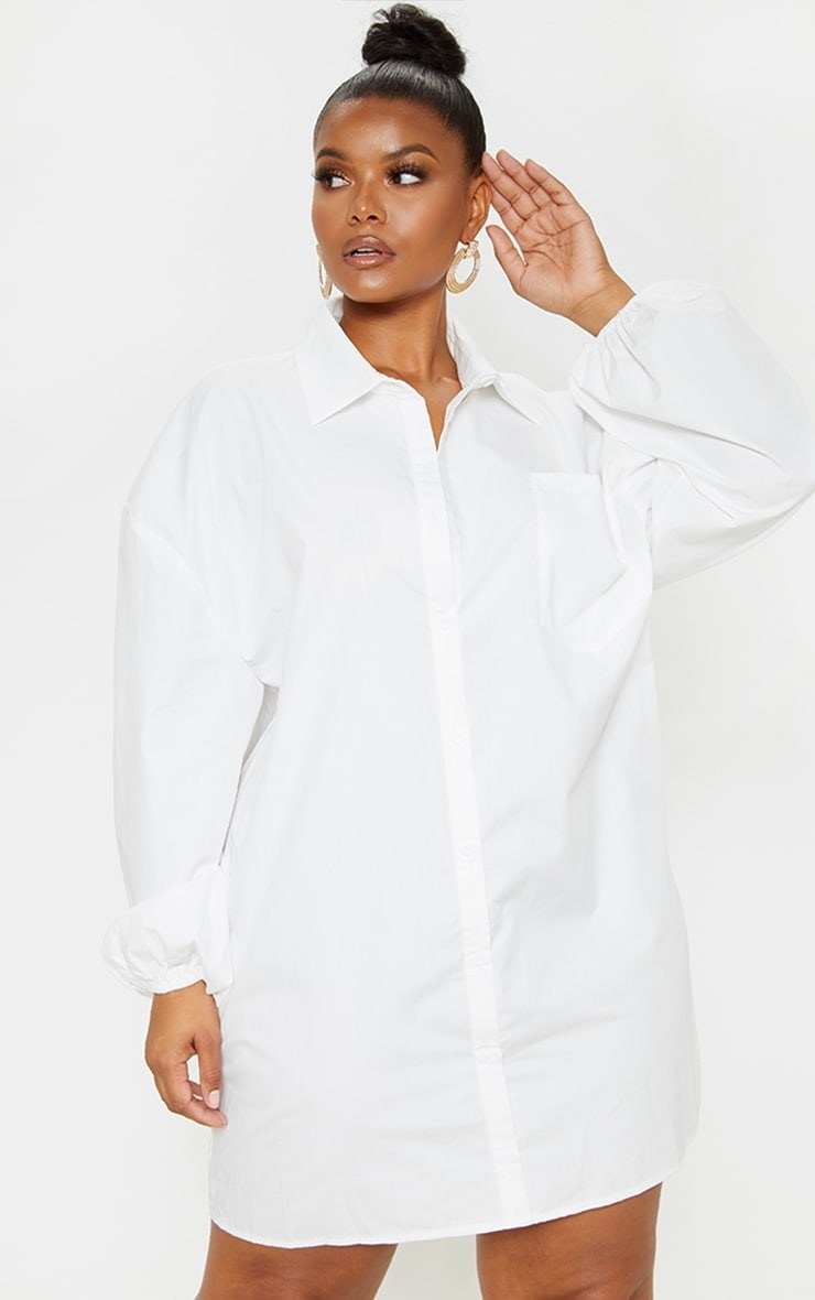 Model wearing white button down dress