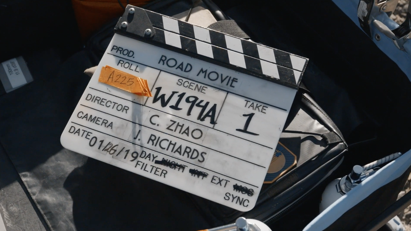 """A film slate with """"Road Movie"""" written on it during production"""