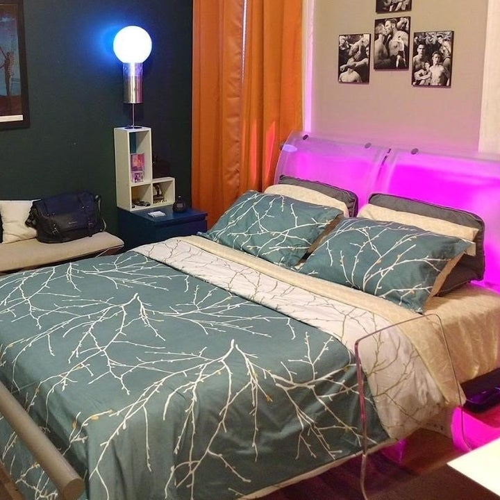 reviewer's teal with white branches duvet and pillow shams on a bed