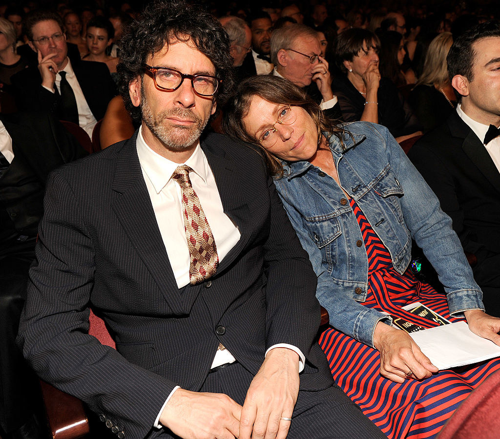 Joel Coen and Frances McDormand sit in the audience of an awards show