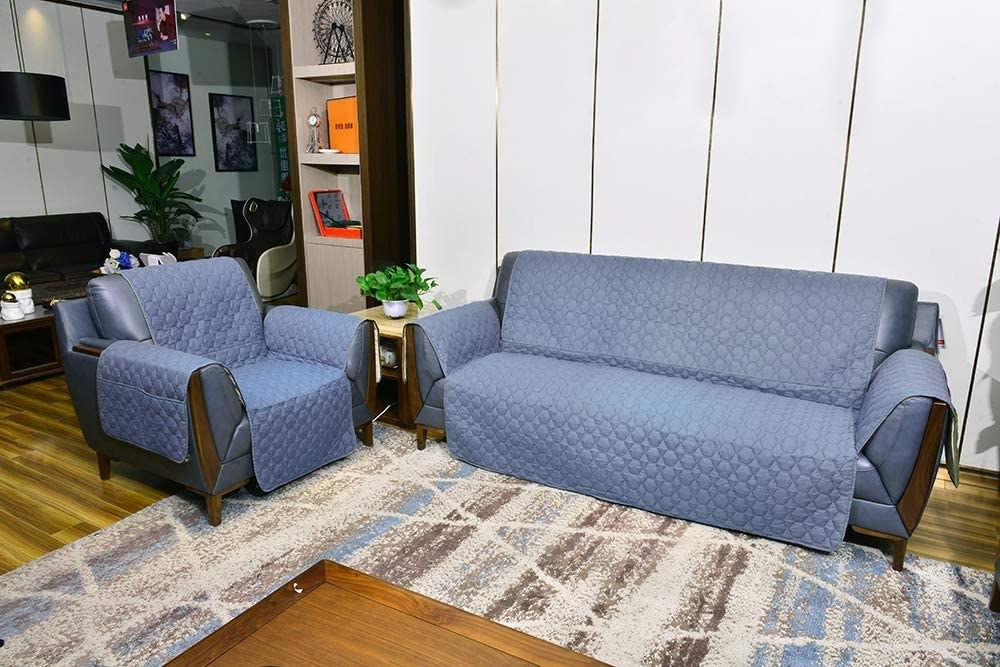 Blue covers on a couch and loveseat