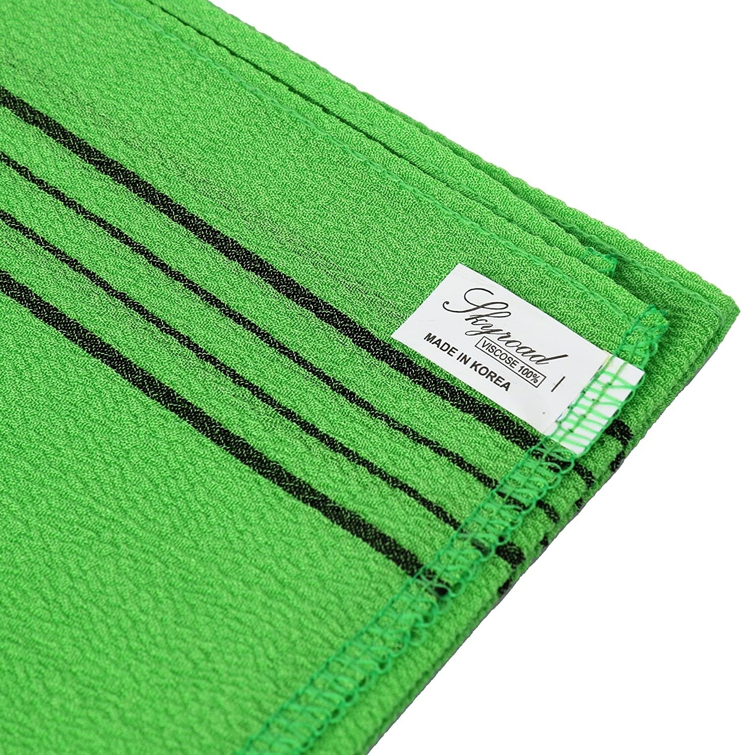 a close-up photo of the green exfoliator