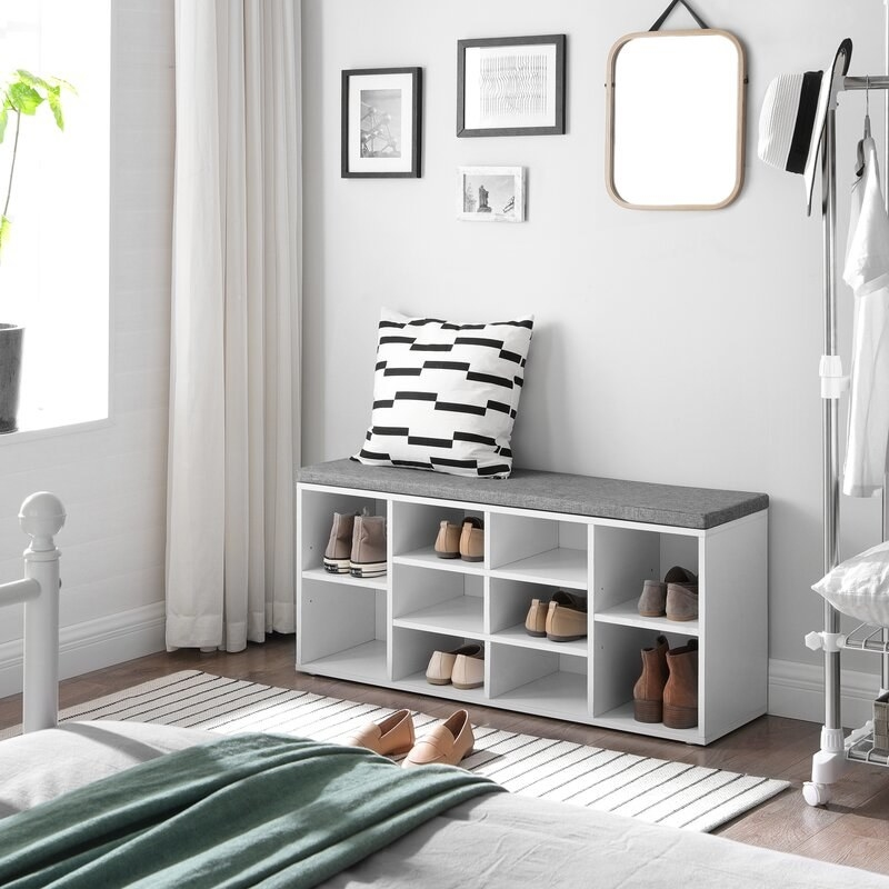 the white cubbie shoe organizer in a bedroom