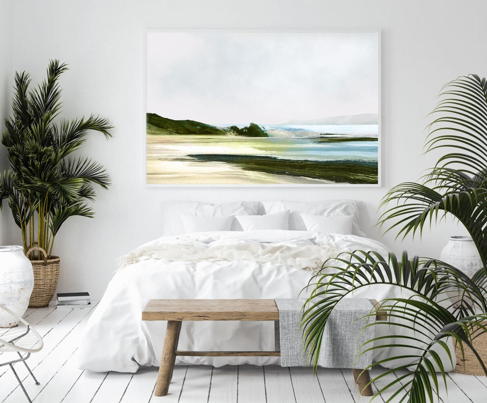 large rectangle art print on the wall that looks like a screne beach scene