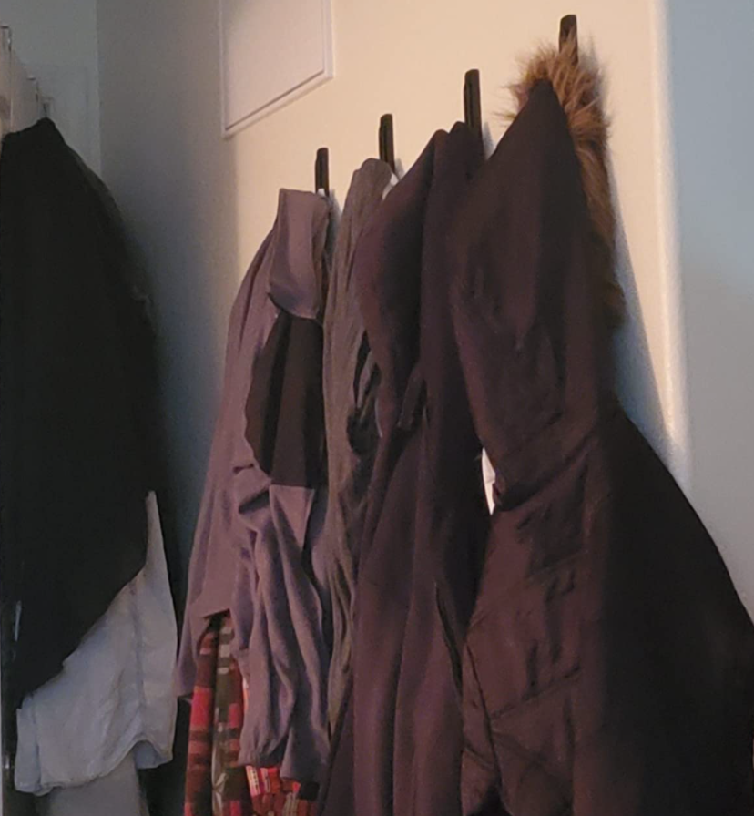 A reviewer's coats on the hooks