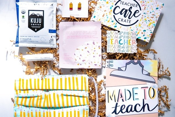 "a notebook that says ""Made to Teach,"" coffee, stickers, snacks, and masks"