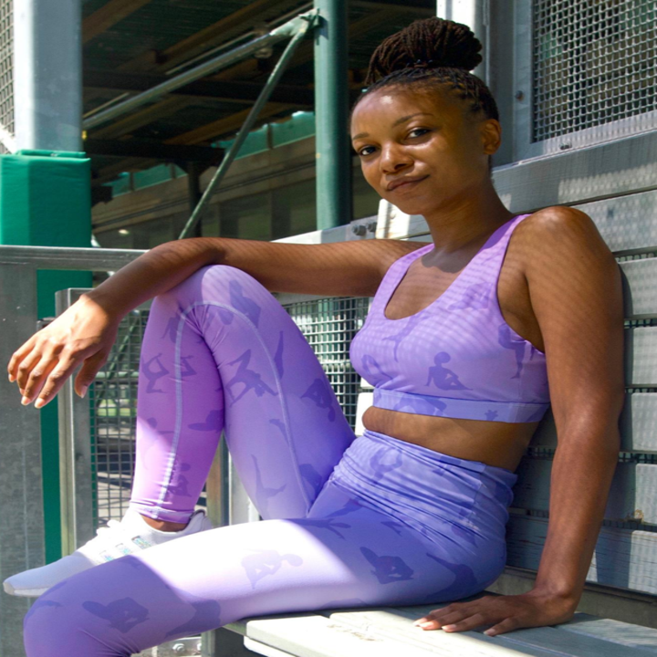 model wears light purple leggings with silhouettes of women working out