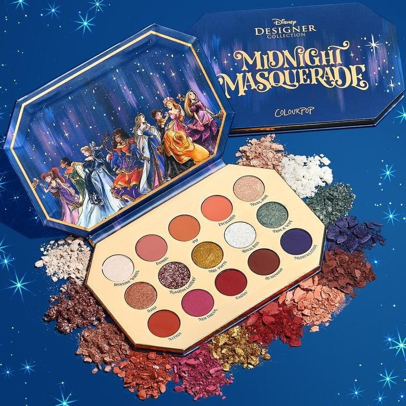 Makeup palette with 15 colors and an illustration of various Disney princesses in masquerade attire