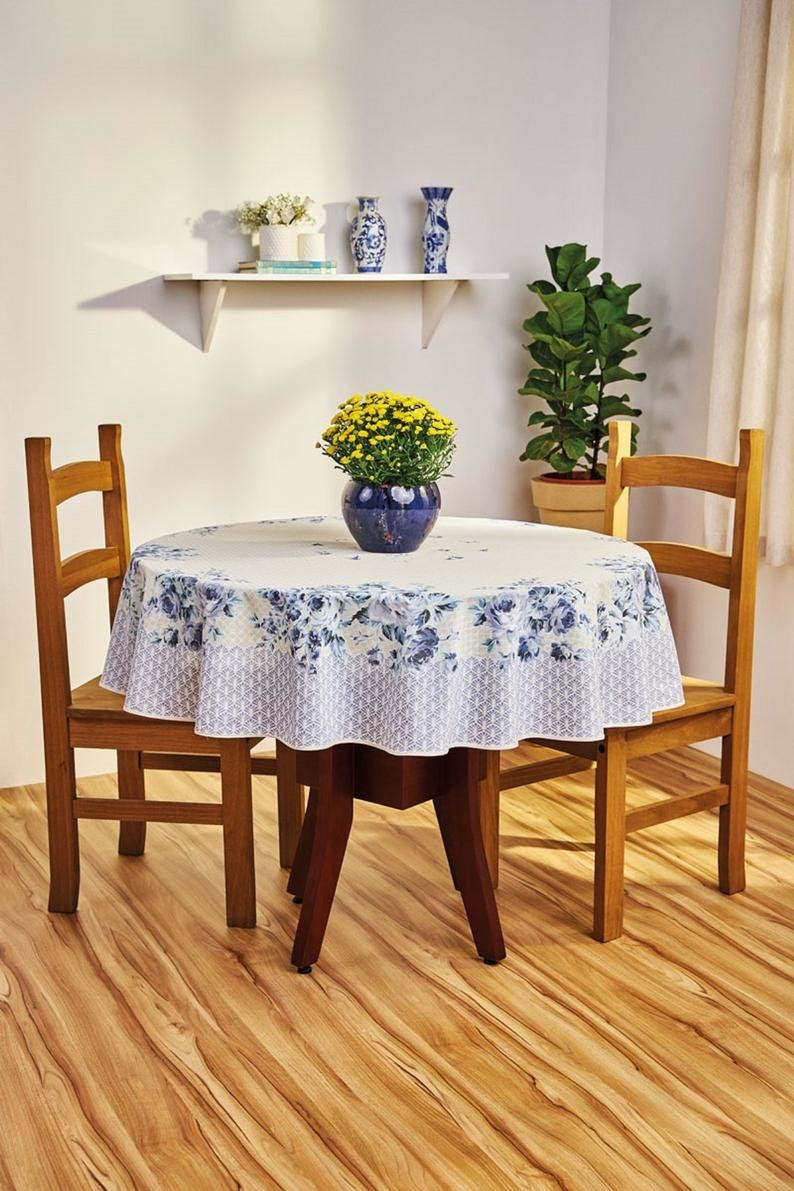 A blue floral tablecloth on a round table